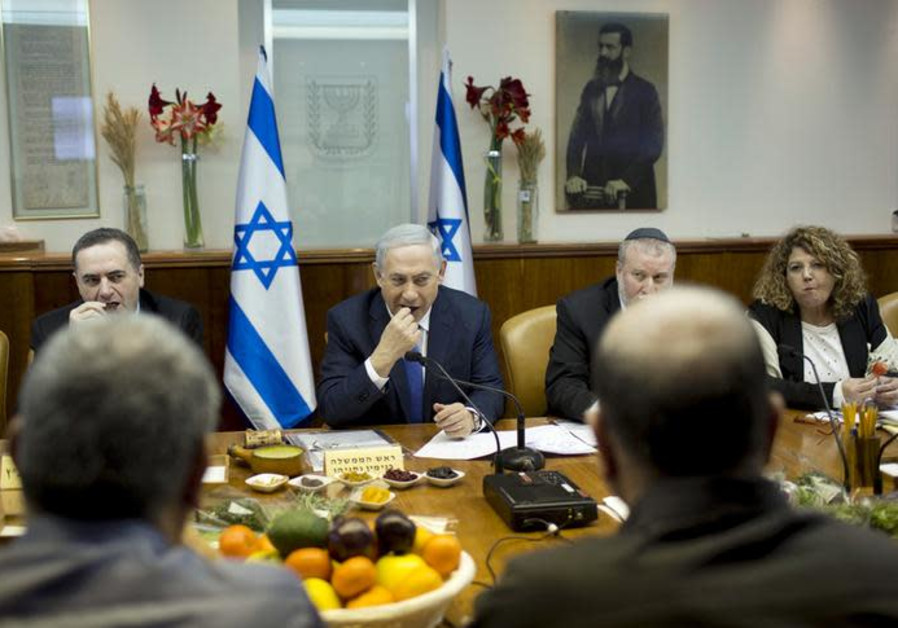 sraeli Prime Minister Benjamin Netanyahu (C) eats fruits and nuts as he marks Tu Bishvat.