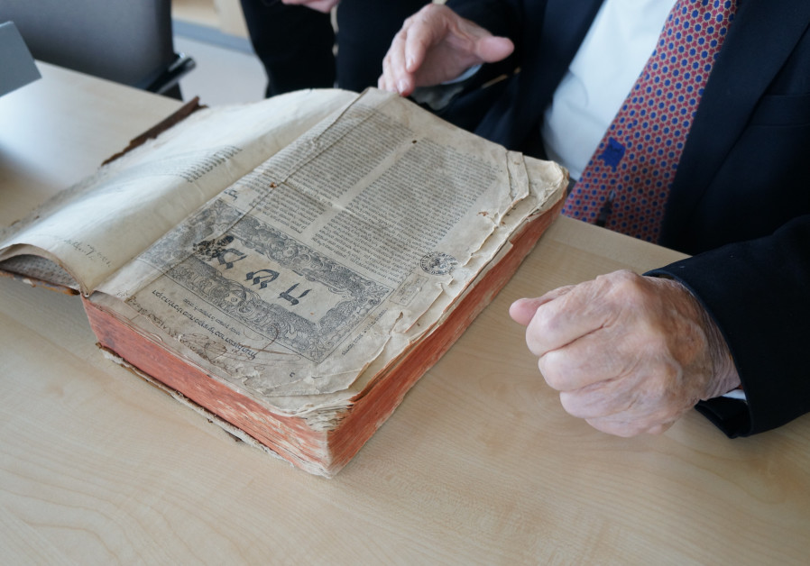 Rare 1546 book looted by Nazis returned to family in Israel