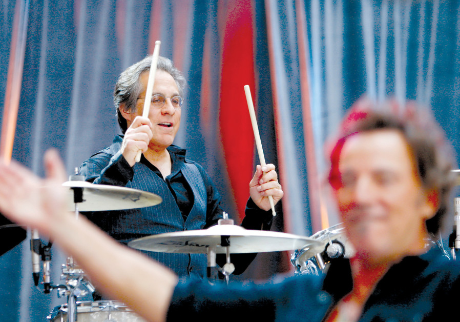 BRUCE SPRINGSTEEN performs with drummer Max Weinberg (top) of E Street Band during a concert at in N