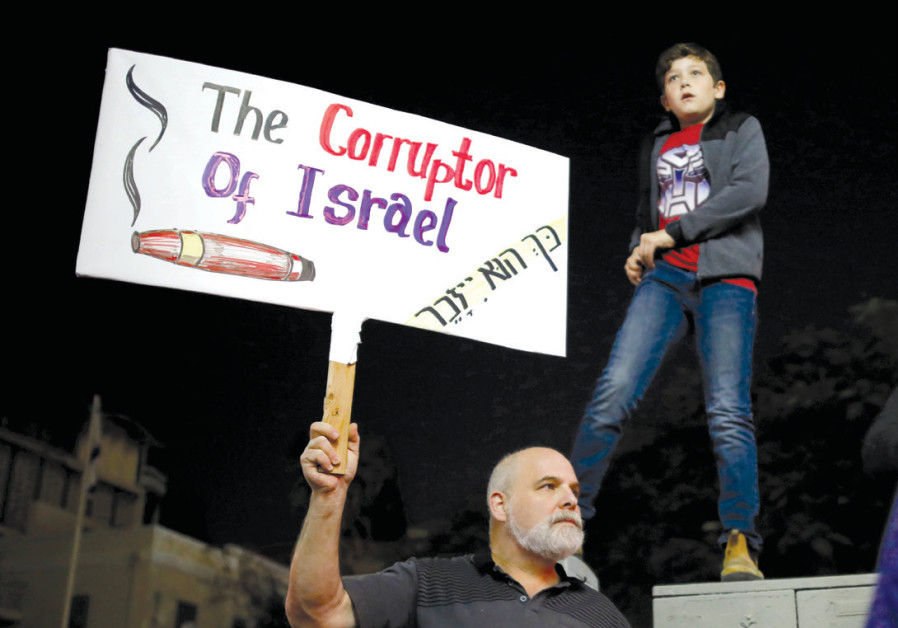 ISRAELIS TAKE PART in a protest against corruption in Tel Aviv last year