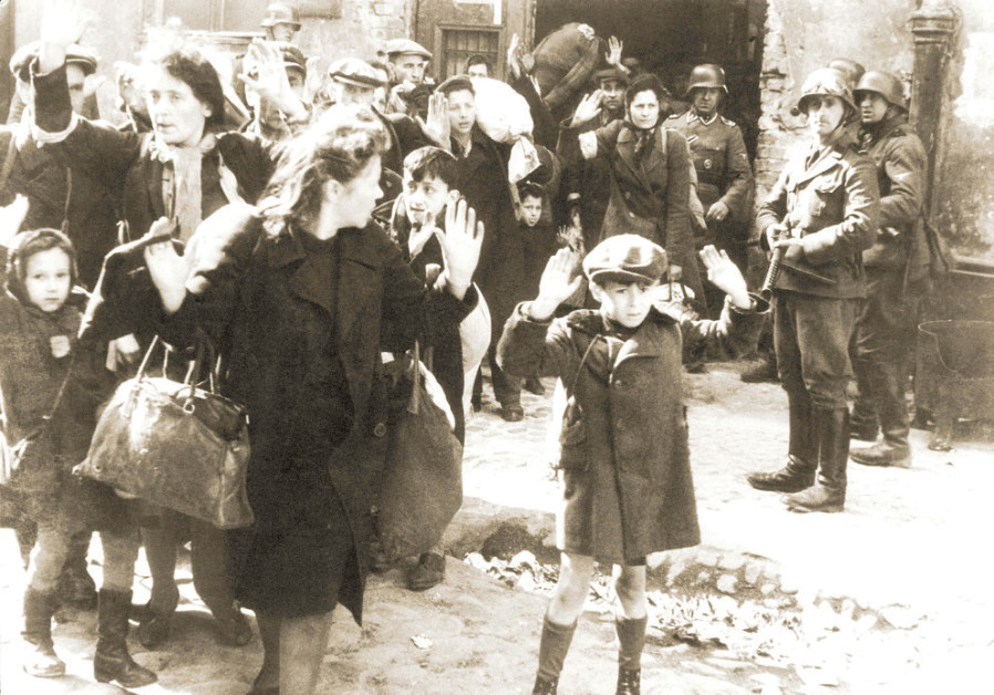 THIS ICONIC photo shows Jews being captured by the Nazis during the Warsaw Ghetto Uprising in May 19