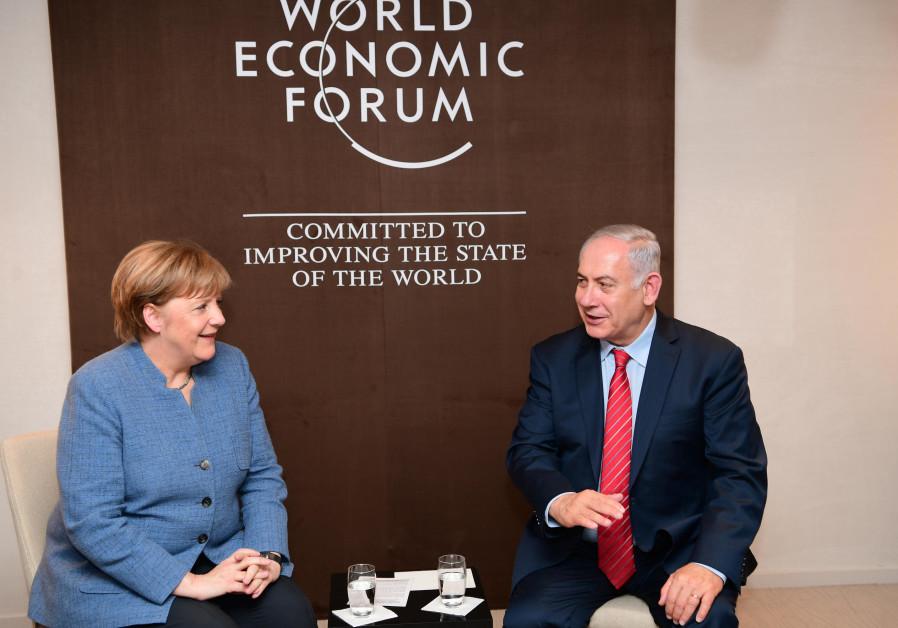 Prime Minister Benjamin Netanyahu and German Chancellor Angela Merkel meet.