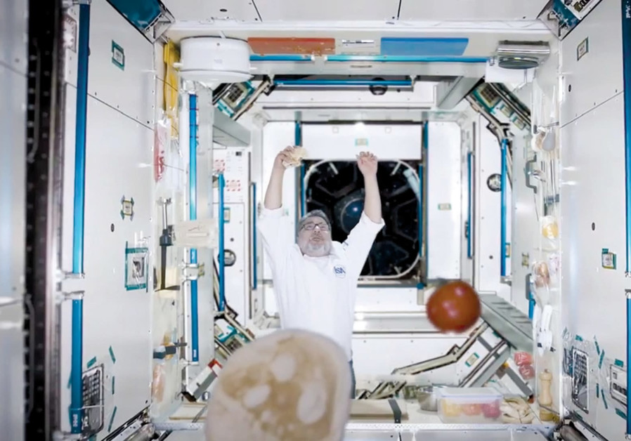 CHEF HAIM COHEN tries to make a falafel in a reenactment of space.
