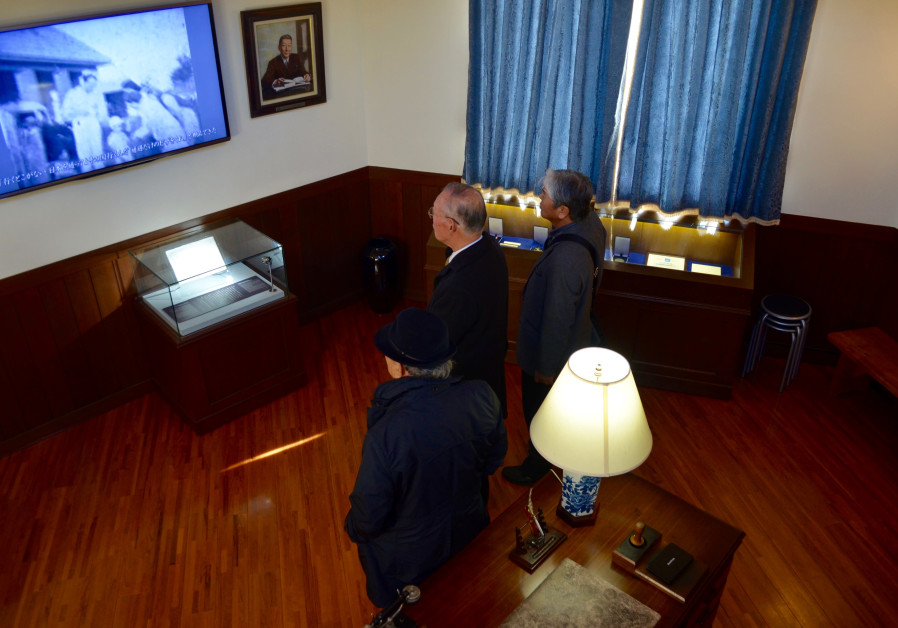 In Chiune Sugihara Memorial Hall in Yaotsu, Japan, locals watch a video documenting his actions in a