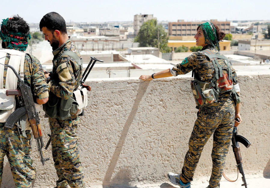 Members of the People's Protection Units in Raqqa last year.