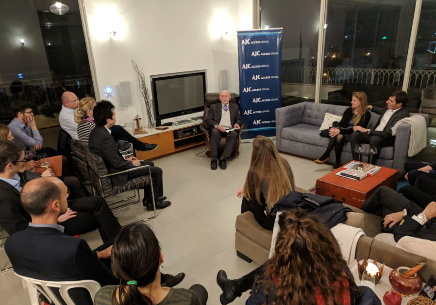 AJC ACCESS members and diplomats listen to Holocaust survivor Sylvian Brachfeld tell his story
