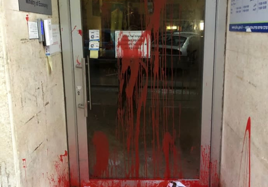 Severed heads and red paint are found outside the entrance the Ministry of Economy office in Tel Avi