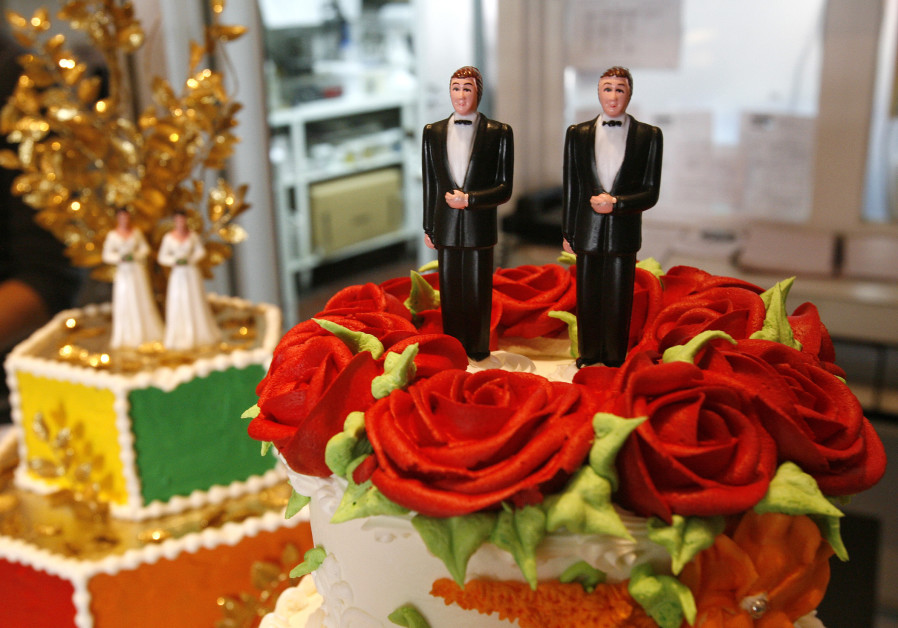 Bride and groom figurines are on display on wedding cakes at Cake and Art bakery in West Hollywood,