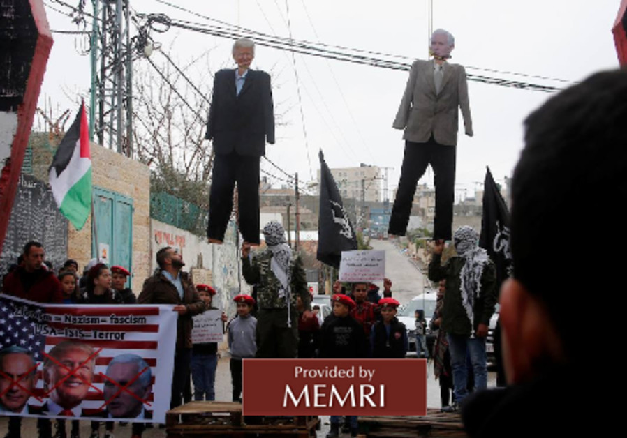 Palestinians hang effigies of US President Donald Trump and US Vice Presdient Mike Pence.