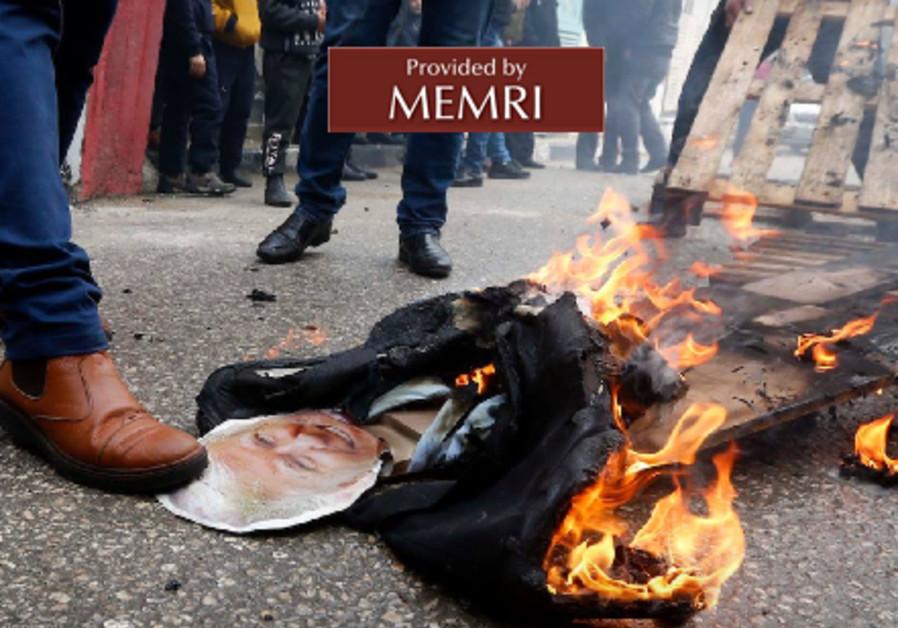 Palestinians burn an effigy of US President Donald Trump on January 27, 2018. (Credit: MEMRI)