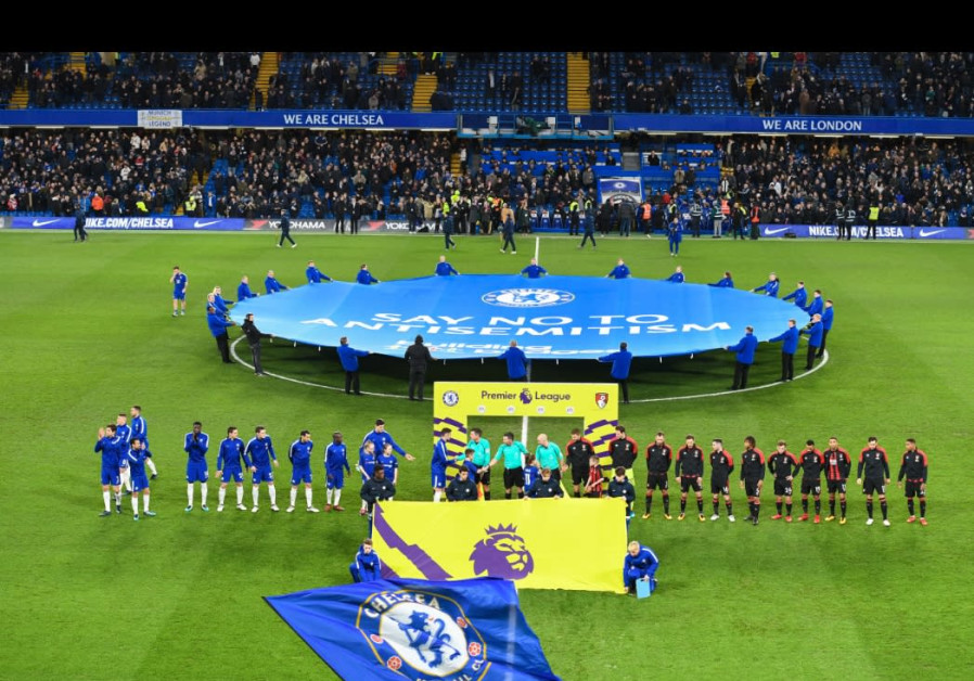 """A banner reading """"Say No To Antisemitism"""" is unfurled at midfield before Chelsea F.C.'s match."""