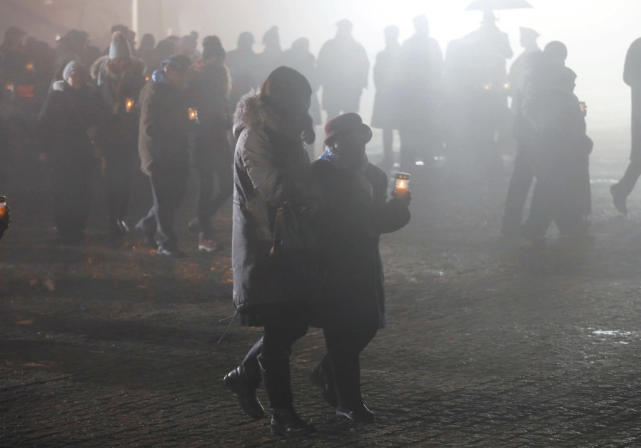 SURVIVORS AND guests light candles at the former Nazi concentration and extermination camp Auschwitz