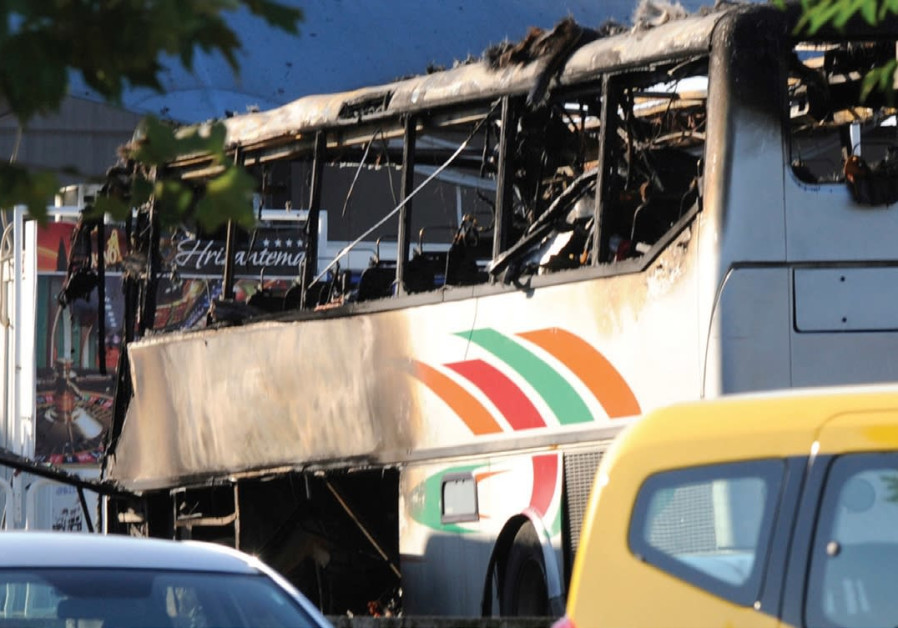 A BUS IS seen at the airport in Burgas, Bulgaria, on July 18, 2012, after terrorists blew it up.