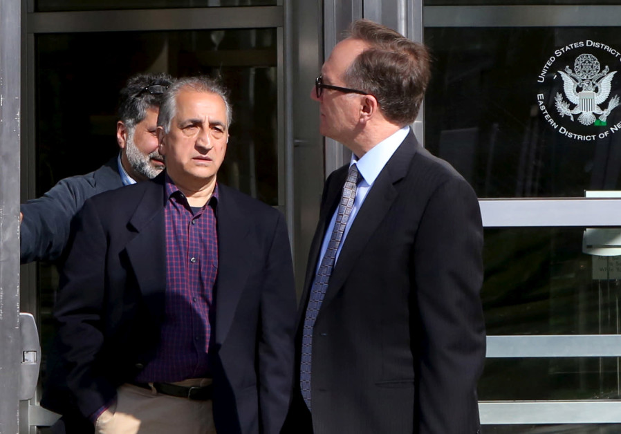 Ahmad Sheikhzadeh (C), a consultant to the Iranian mission to the United Nation, leaves Brooklyn Fed