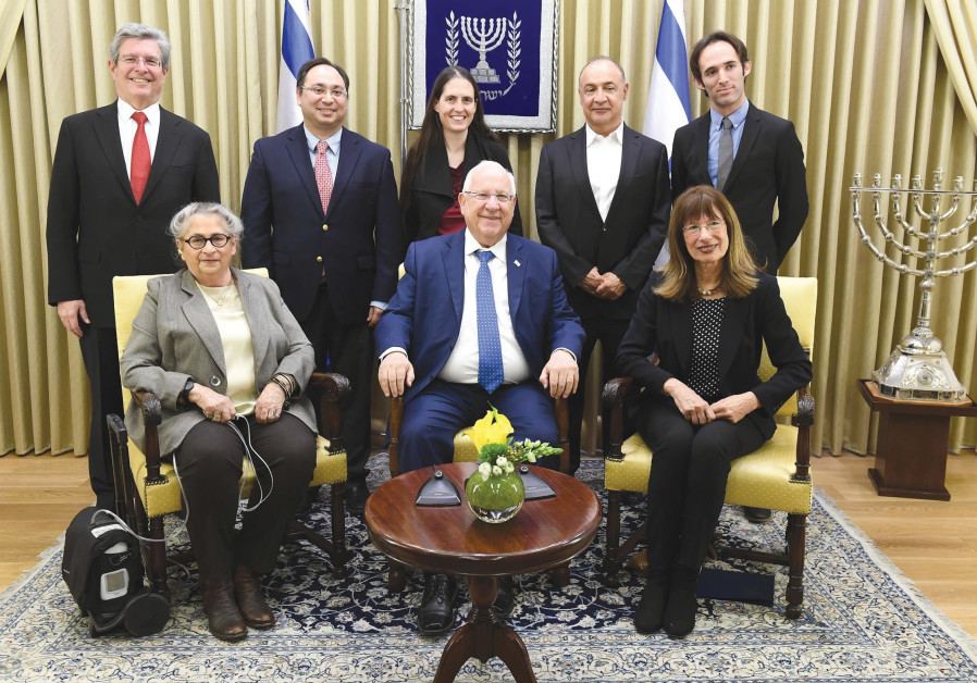 President Reuven Rivlin and his wife, Nechama (seated at left), host a reception yesterday for winne