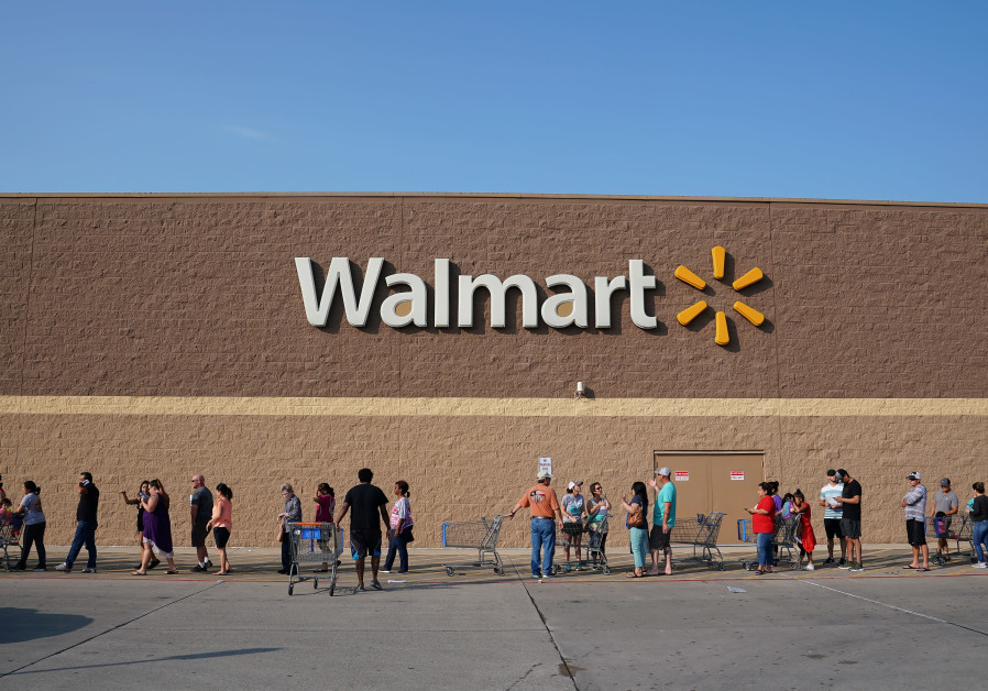 People line up outside a Walmart store