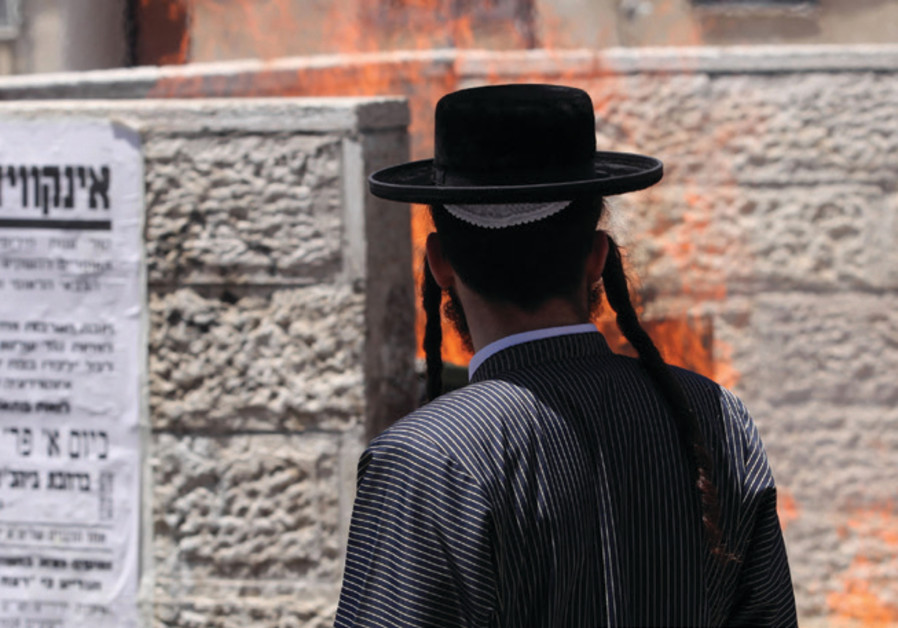 A young Haredi man outside the IDF enlistment office in Jerusalem