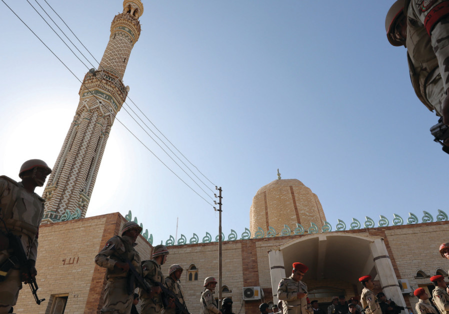 Egyptian soldiers secure worshipers outside Al Rawdah Mosque in Bir Al-Abed on December 1, 2017, dur