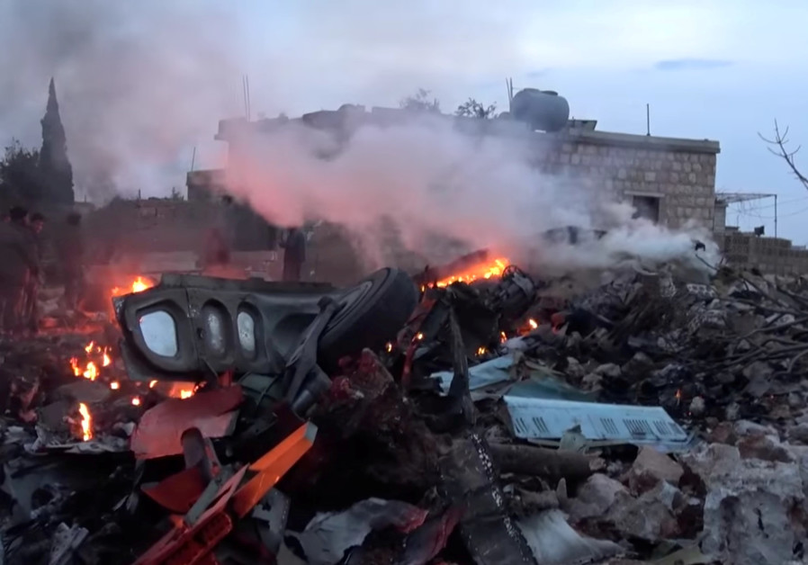 The aftermath of a Russian warplane shot down by Syrian rebels in Idlib, Syria