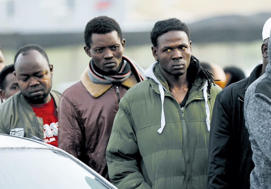 African migrants wait in line for the Population and Immigration Authority office to open in Bnei Br