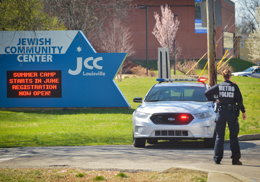 A police officer blocks an entrance as officials respond to a bomb threat at the Jewish Community Ce