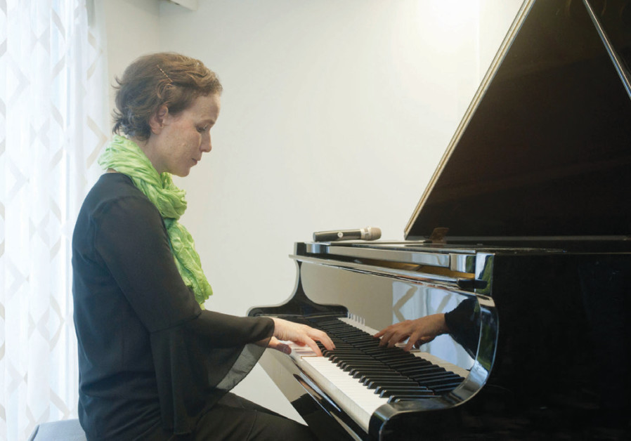 PIANIST OFRA Yitzchaki tickles the ivories piano