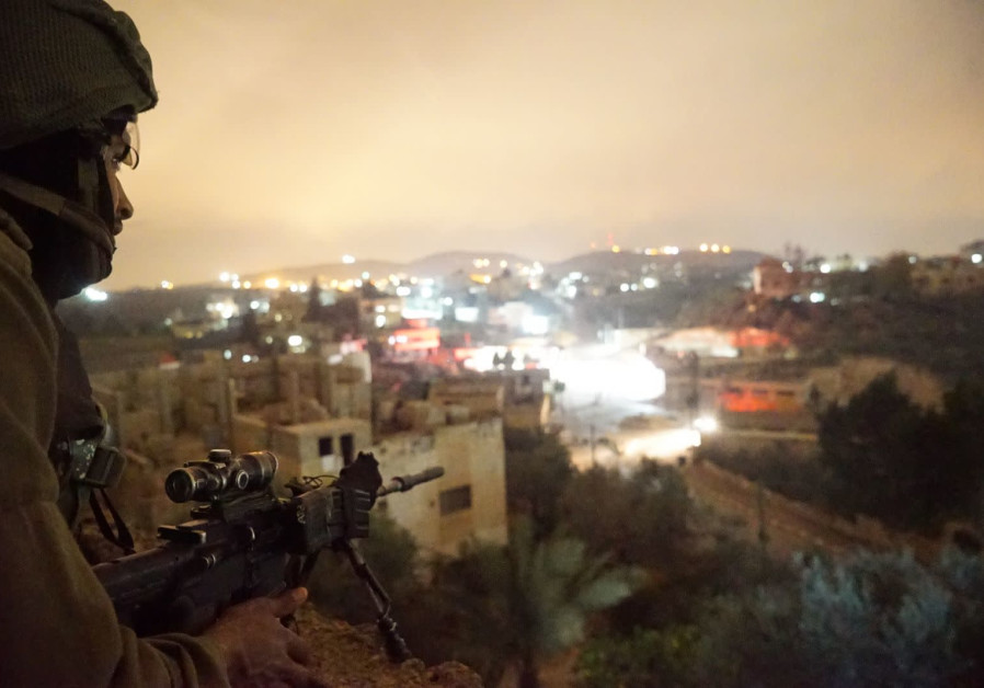 An IDF sniper during a raid the West Bank village of Al-Yamun