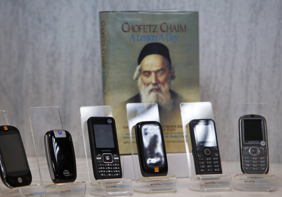Kosher cellular phones, imported and distributed by Israeli Accel Telecom, are displayed in Tel Aviv