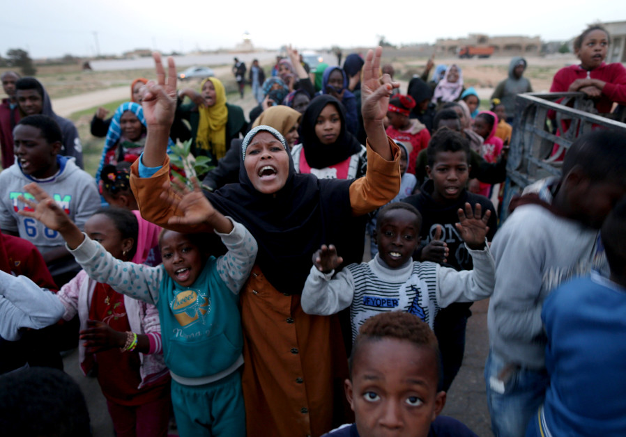 Libyan displaced from the town of Tawergha protest in their camp in Benghazi, Libya