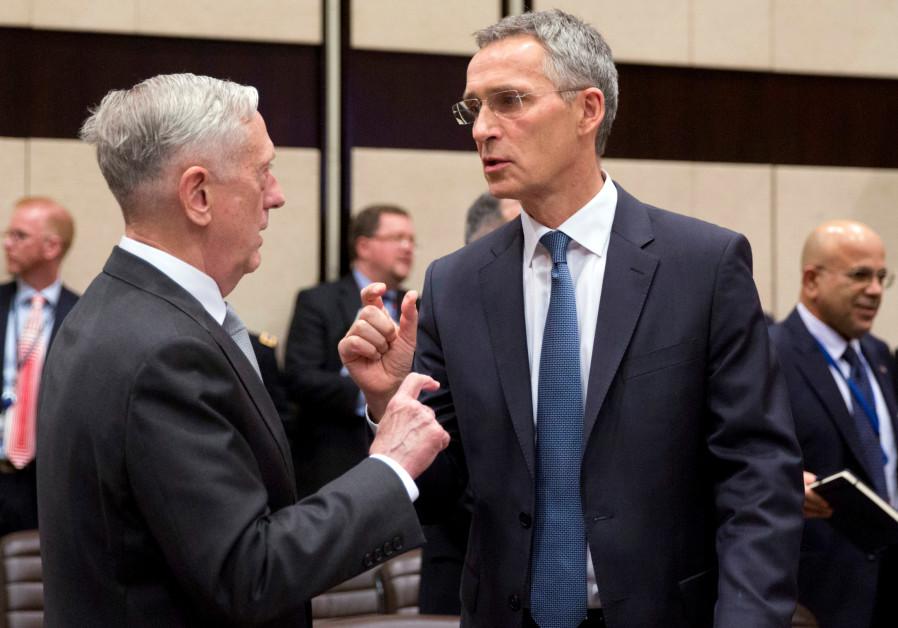 US Secretary for Defense Jim Mattis talks with NATO Secretary General Jens Stoltenberg prior to a