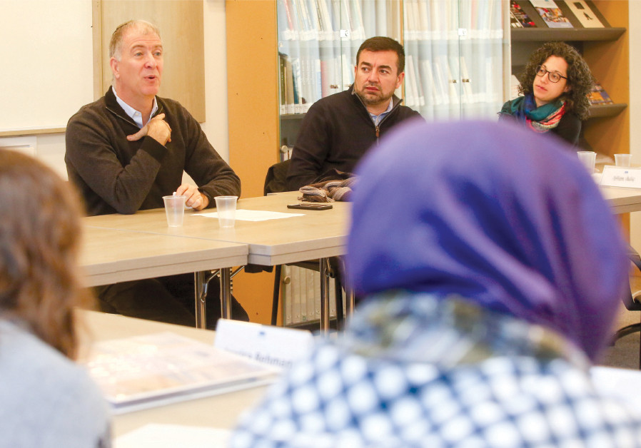 RABBI DONNIEL HARTMAN (left) speaks to the MLI participants at the Shalom Hartman Institute, as MLI