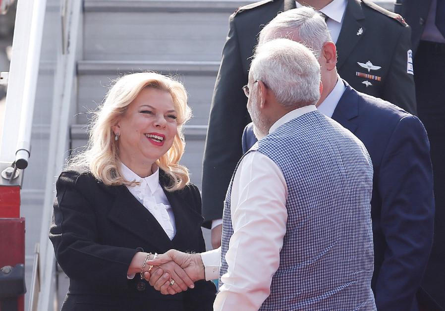 SARA NETANYAHU shakes hands with India's Prime Minister Narendra Modi as Prime Minister Benjamin Net