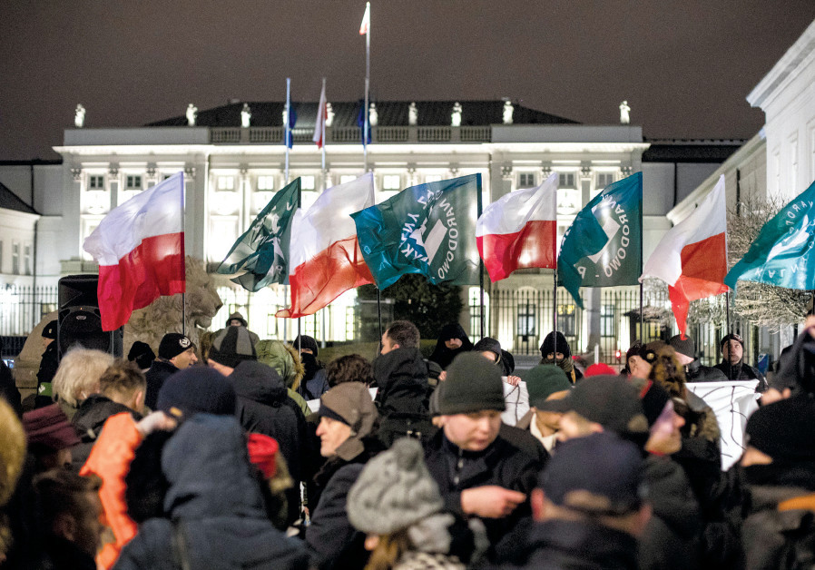 SUPPORTERS OF the Polish National Radical Camp Party gather in support of the Holocaust bill in fron