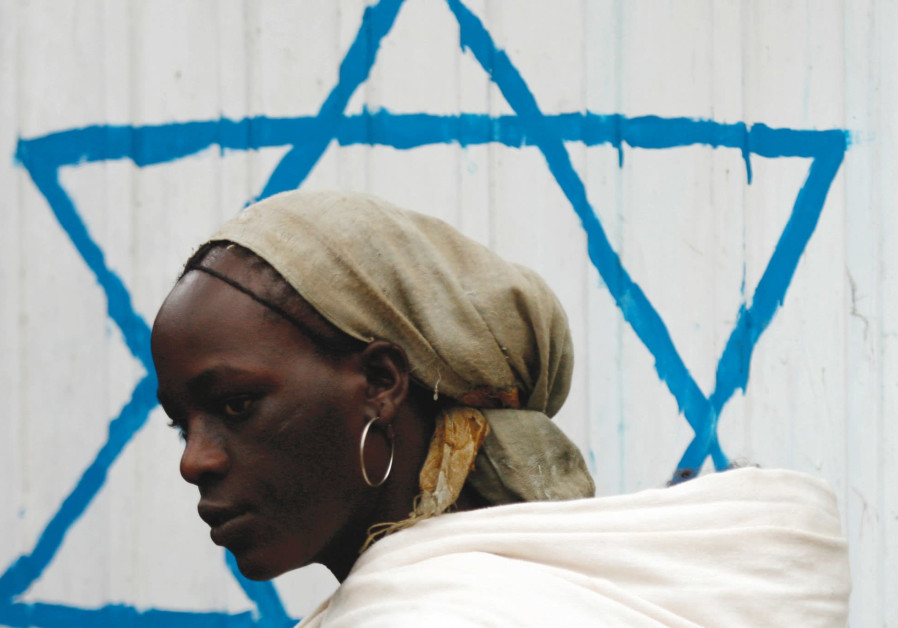 An Ethiopian Jewish woman arrives for the beginning of the Rosh Hashanah services at a synagogue in