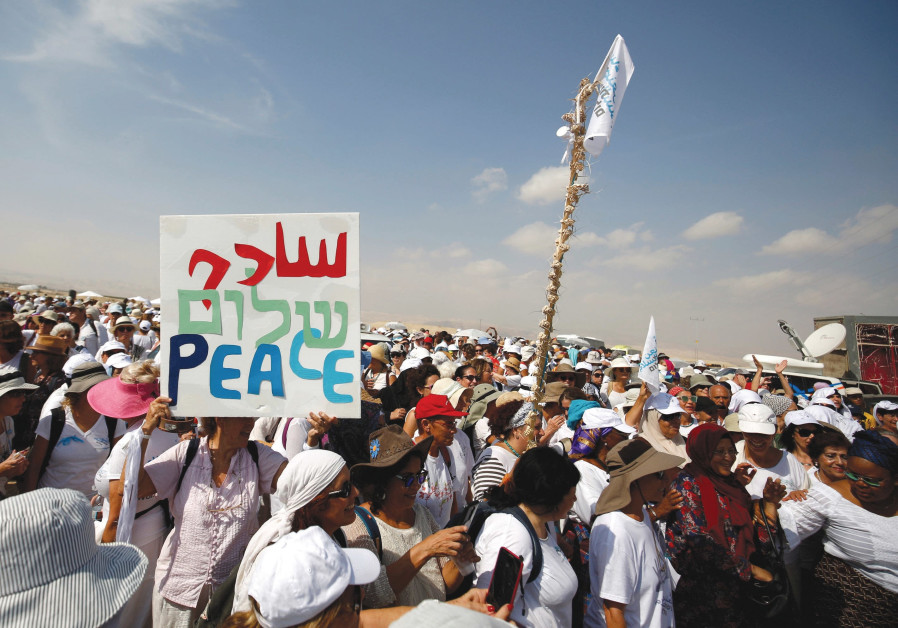 Activists march in support of peace.