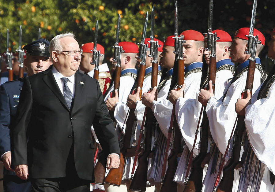 PRESIDENT REUVEN RIVLIN inspects a guard of honour during a welcome ceremony in Athens in January.