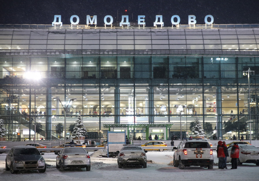 Emergency personel stand outside Domodedovo International Airport on February 11, 2018