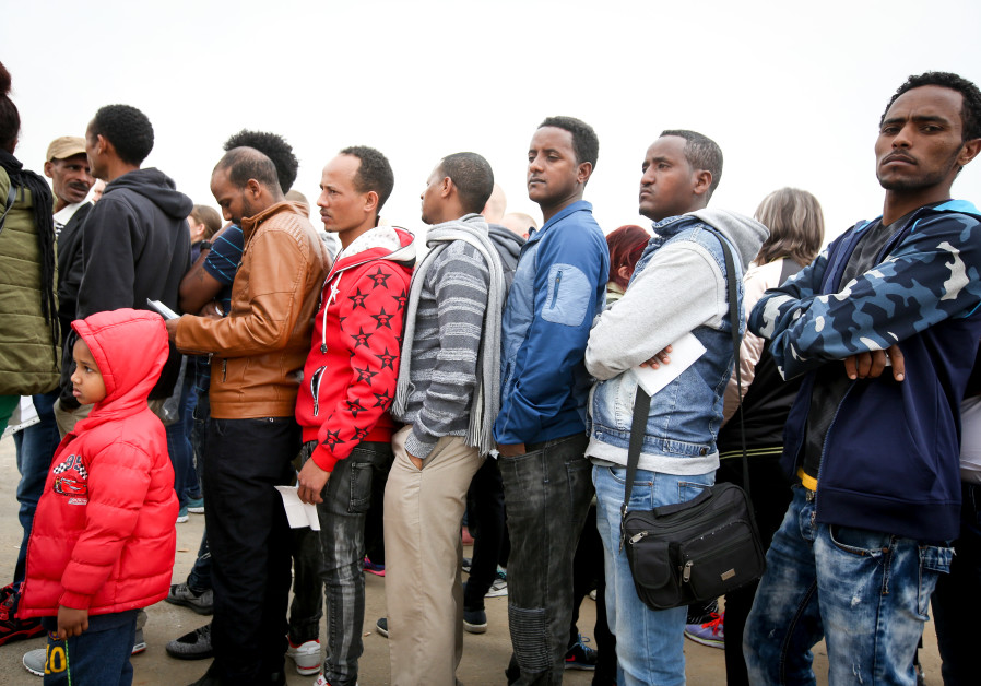 African asylum seekers line up to apply for a visa in Bnei Brak, Israel