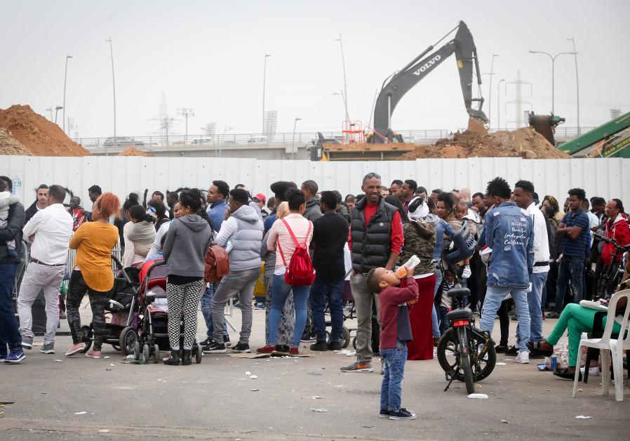 African asylum seekers wait to apply for a visa in Bnei Brak, Israel