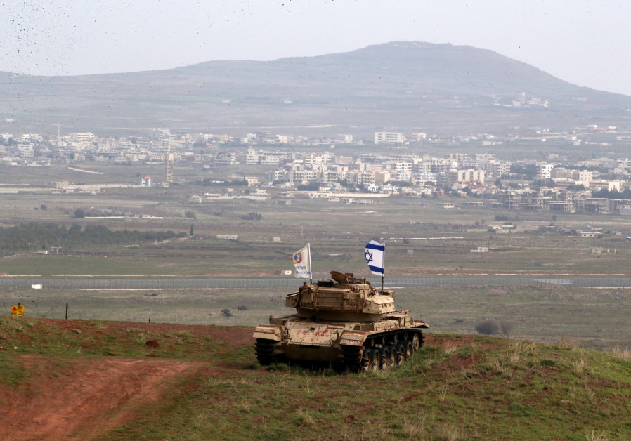 An old military vehicle can be seen positioned on the Israeli side of the border with Syria, near th