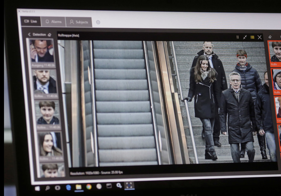 A computer with an automatic facial recognition system shows German Interior Minister Thomas de Maiz