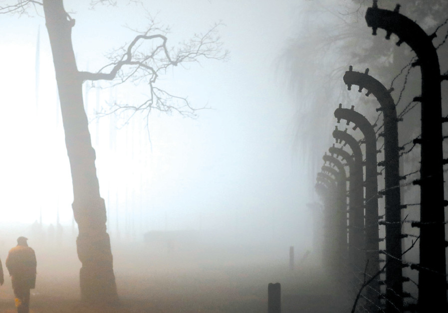 THE PERIMETER fence of Auschwitz II-Birkenau is enveloped in a thick evening fog during the ceremoni