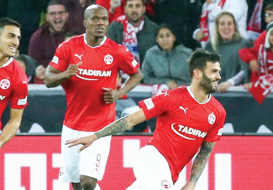 Hapoel Beersheba midfielder Hanan Maman (right) celebrates after scoring one of his two goals.