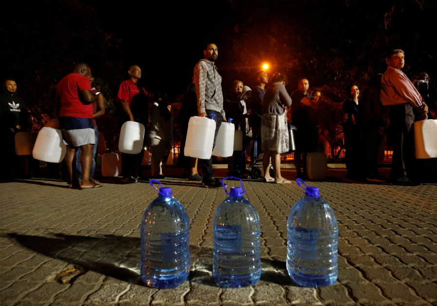 People queue to collect water during a water crisis in Cape Town, South Africa