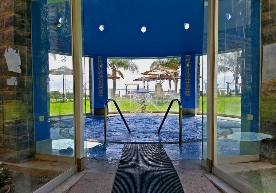 Galei Kinneret's spa jacuzzi with a view overlooking the terrace and water. (Credit: courtesy)