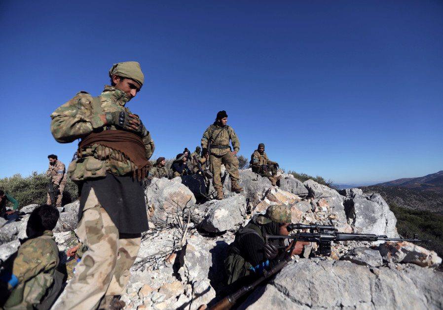Turkish-backed Free Syrian Army fighters are seen near the city of Afrin, Syria