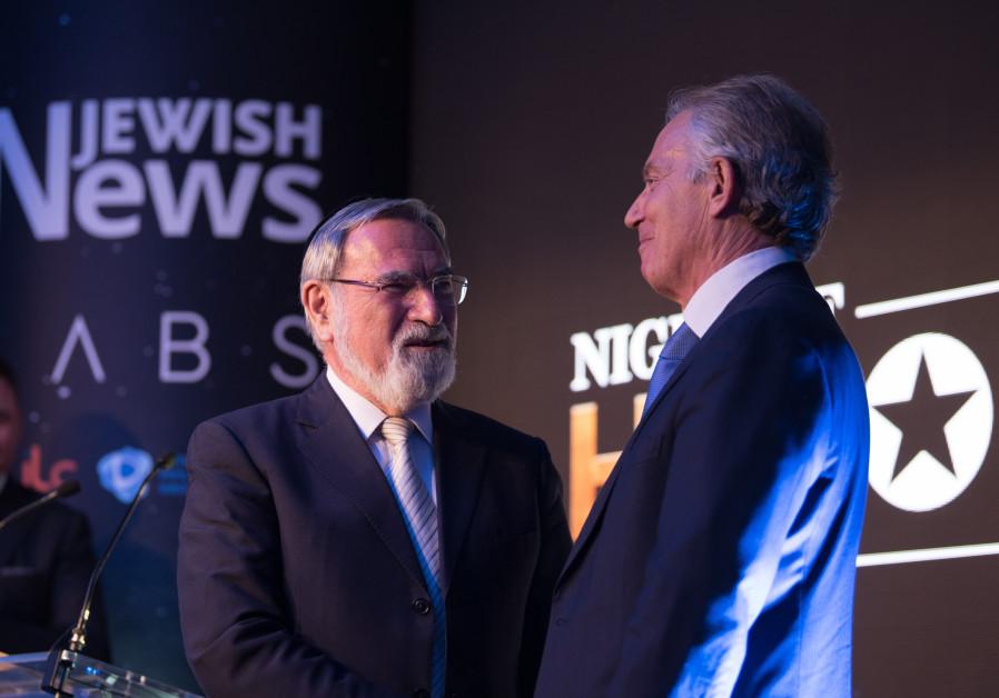Former prime minister Tony Blair presents Lord Rabbi Jonathan Sacks with a Lifetime Achievement awar