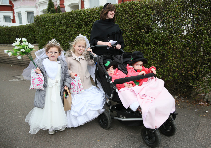A Jewish family dressed in costumes celebrates the festival of Purim
