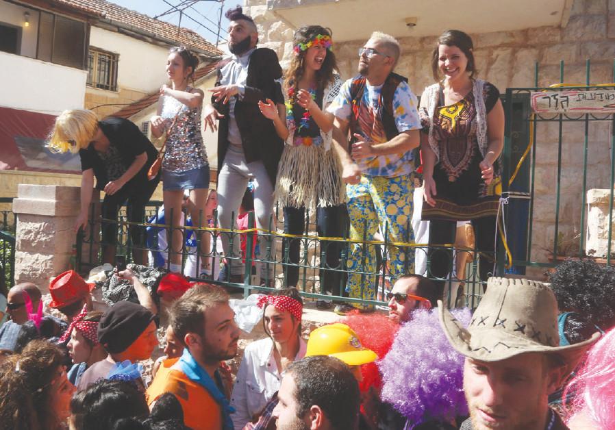 Purim revelers in the Nahlaot neighborhood