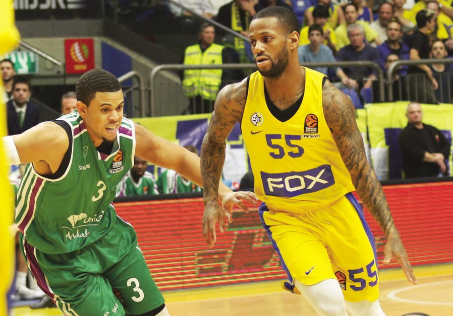 Maccabi Tel Aviv guard Pierre Jackson (right) drives past Unicaja Malaga's Ray McCallum (left) durin